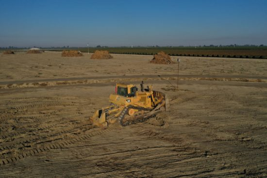 Farm equipment leveling land
