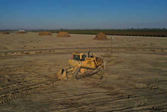 Farm equipment leveling land